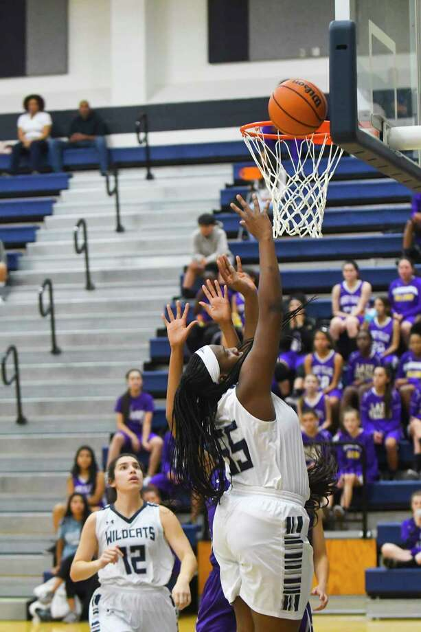 The Lady Wildcats were led in the loss to Jersey Village by senior center Essence Richards, who finished the game with 16 points. Richards, who dominated the paint the entire game, will anchor the team all season from the post. Photo: Tony Gaines/ HCN, Photographer