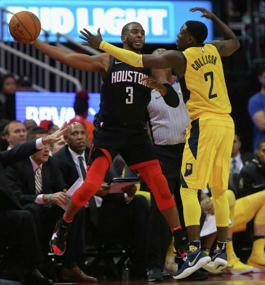 Houston Rockets guard Chris Paul (3) stretches his arm to make a pass around Indiana Pacers guard Darren Collison (2) during the fourth quarter of a NBA game at Toyota Center on Wednesday, Nov. 29, 2017, in Houston. The Houston Rockets defeated the Indiana Pacers 118-97. ( Yi-Chin Lee / Houston Chronicle ) Photo: Yi-Chin Lee, Houston Chronicle / © 2017  Houston Chronicle