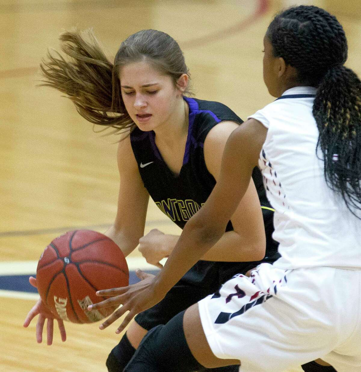Montgomery guard Lindsey Hefner (21) tries to control the ball as Katy Tompkins guard Crystal Smith (5) gives pressure during the first quarter of a high school girls basketball game in the Phillips 66 Classic at Katy Tompkins High School, Thursday, Nov. 30, 2017, in Katy.