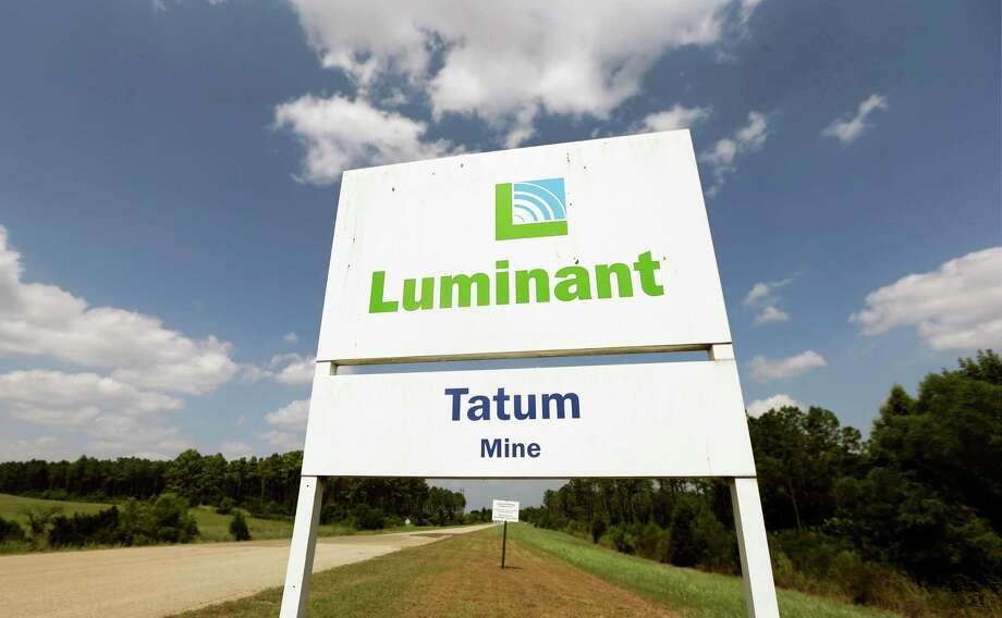 This July 29, 2013, file photo shows the entrance to a Luminant Mining Co. coal mine in Tatum, Texas. Energy Future Holdings filed for Chapter 11 bankruptcy reorganization in a Delaware court on Tuesday, April 29, 2014, an expected move that will not harm power production or distribution in Texas as the company halves its $40 billion debt load. The company owns TXU Energy, a retail electricity provider, and Luminant, the state's largest power generator.  (AP Photo/LM Otero, File) Photo: LM Otero, STF / AP