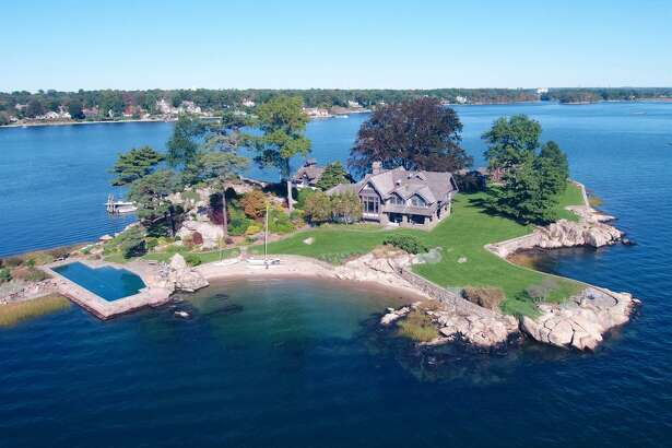 Tavern Island is back on the market for $8.7 million. Accessed via a five minute boat ride from the mainland address at 75 Bluff Avenue in Rowayton, the island compound has been immaculately maintained and includes five structures.