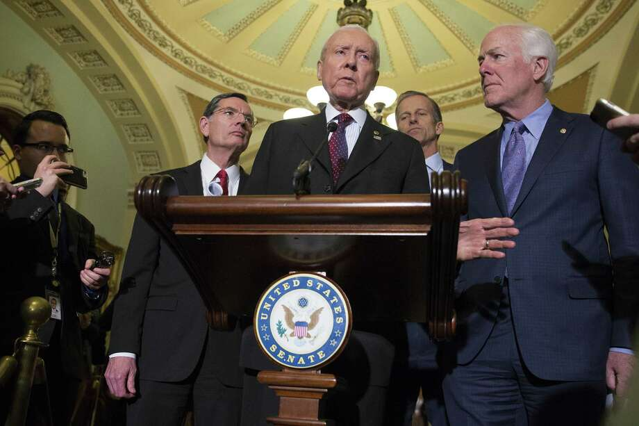 Sen. Orrin Hatch (R-Utah), center, with other Senate Republicans, speaks during a news conference on Capitol Hill Nov. 28. The Senate Budget Committee voted along party lines Tuesday, 12 to 11, to approve the Republican tax legislation, clearing the way for a full Senate vote. Photo: TOM BRENNER /NYT / NYTNS