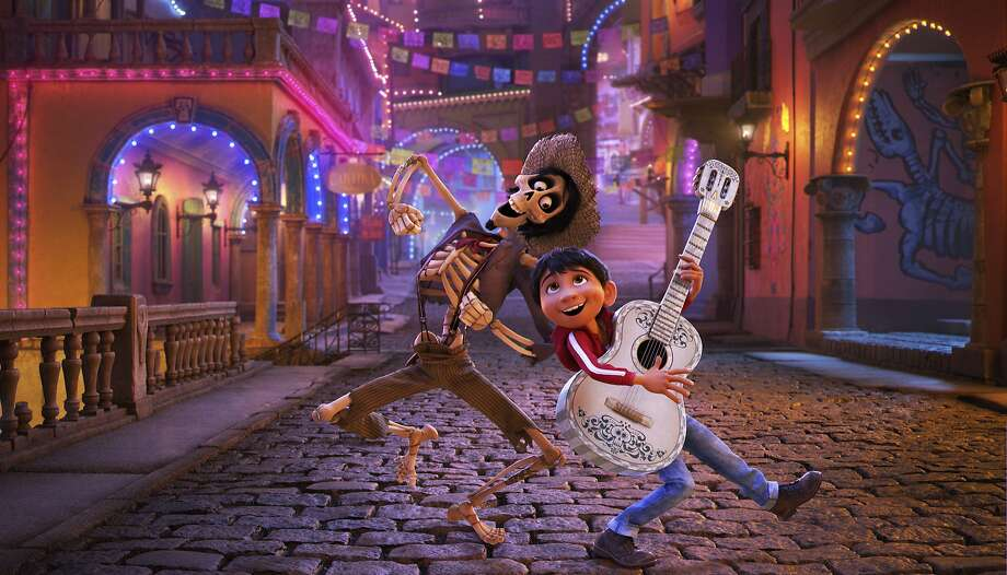 """In this image released by Disney-Pixar, character Hector, voiced by Gael Garcia Bernal, left, and Miguel, voiced by Anthony Gonzalez, appear in a scene from the animated film, """"Coco."""" (Disney-Pixar via AP) Photo: Pixar, Associated Press"""
