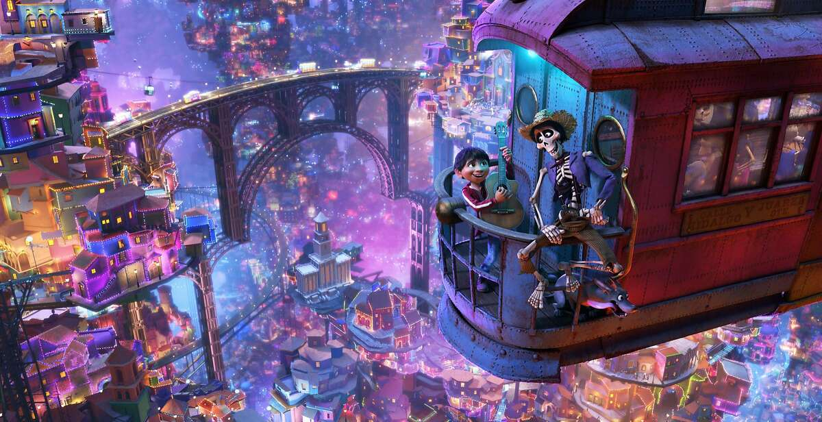 """In this image released by Disney-Pixar, character Hector, voiced by Gael Garcia Bernal, right, and Miguel, voiced by Anthony Gonzalez, appear in a scene from the animated film, """"Coco."""" (Disney-Pixar via AP)"""