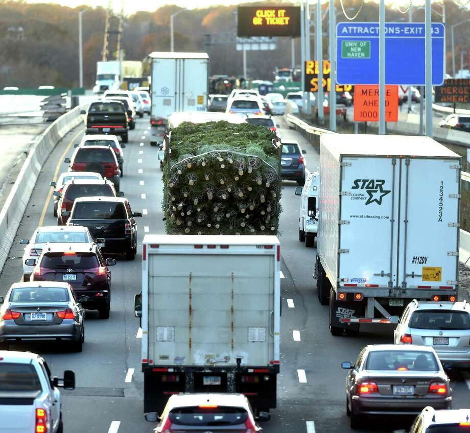 A truck carrying Christmas trees travels south on I-95 through New Haven on November 22, 2017. Photo: Arnold Gold / Hearst Connecticut Media / New Haven Register