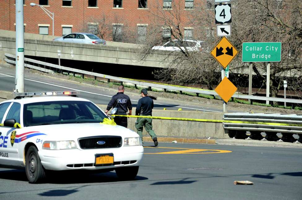 Troy police investigate an incident Sunday, April 17, 2016, that involved a suspect allegedly pinning a Troy police officer with his car, with the officer shooting into the car killing the suspect. Sgt. Randall French fatally shot Edson Thevenin of Colonie on the Collar City Bridge following a brief chase. (Paul Buckowski / Times Union)