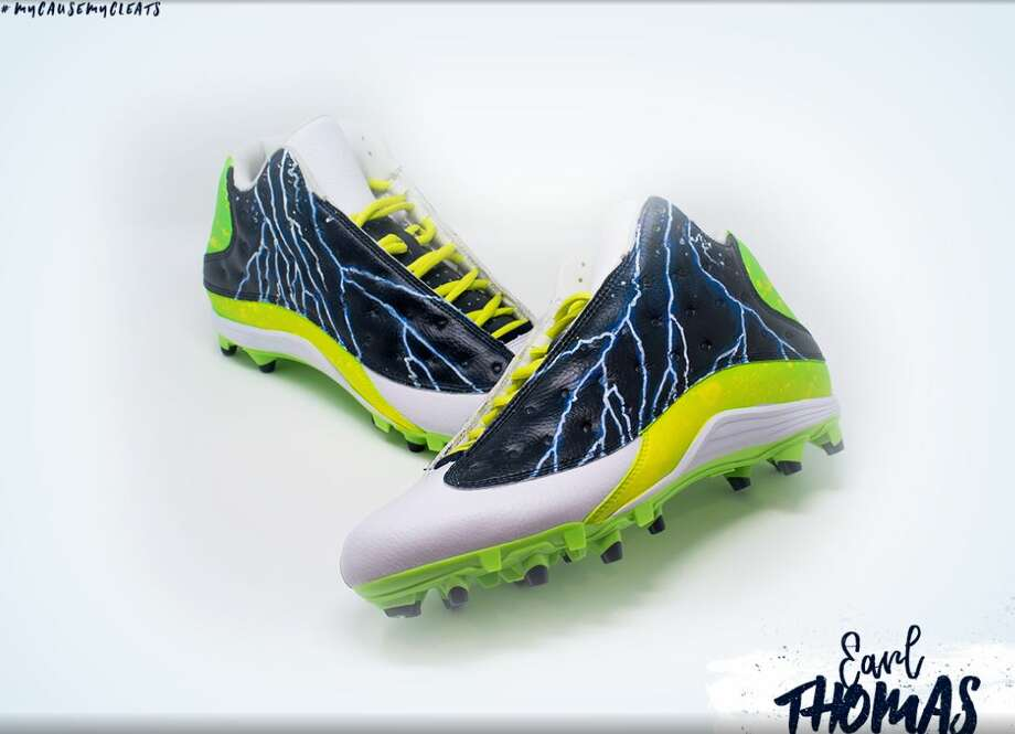 Earl Thomas will auction off these cleats for an Orange football league.