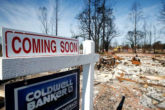 A residential lot at 1673 Hopper Avenue in the Coffey Park neighborhood and destroyed in last month's Tubbs Fire is listed for sale in Santa Rosa, Calif. on Thursday, Nov. 30, 2017.