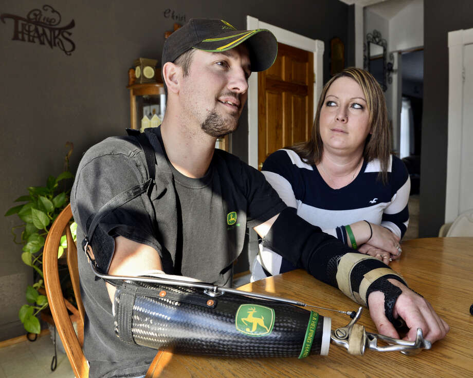 Jamie Houdek and his wife, Lisa, talk about his losing a hand to a corn picker on their Minnesota farm. Even seasoned farmers can make mistakes in a moment of haste, he says.  Photo: Kimm Anderson, MBR / St. Cloud Times