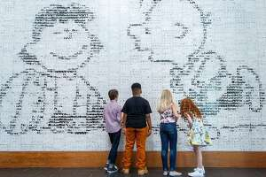 (L-R) Noah Schnapp, the voice of Charlie Brown in The Peanuts Movie, Mar Mar, the voice of Franklin, Hadley Miller, the voice of Lucy and Francesca Capaldi, the voice of Little Red-Head Girl, check out the comic strips at the Charles M. Schulz Museum, Friday, July 24, 2015, in Santa Rosa, Calif.