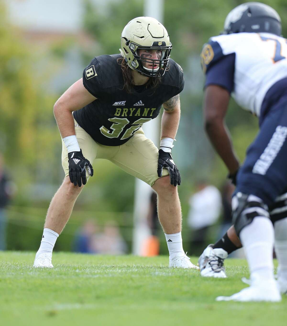 Byrant's Thomas Costigan, a Stamford native and 2015 Trinity Catholic graduate, has been named the 2017 Northeast Conference Defensive Player of the Year and named to the All-New England football team.