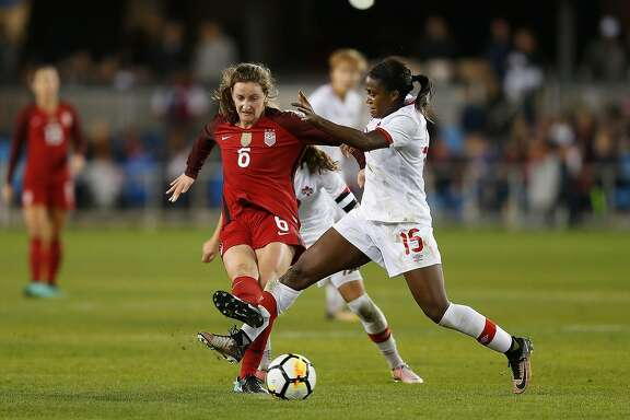 SAN JOSE, CA - NOVEMBER 12: Nichelle Prince #15 of Canada competes for the ball against Andi Sullivan #6 of the United States at Avaya Stadium on November 12, 2017 in San Jose, California.  (Photo by Lachlan Cunningham/Getty Images)