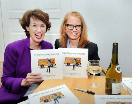 "Greenwich residents Jane Condon, left, and Bobbie Eggers, recently published their book, ""Chardonnay Moms,"" featuring their greatest-hits cartoons. The pair pokes fun at the lighter side of Greenwich. Photo: Bob Luckey Jr. / Hearst Connecticut Media / Greenwich Time"