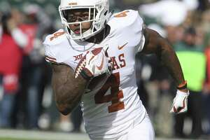 Texas safety DeShon Elliott returns an interception for a touchdown against Baylor in the first half of an NCAA college football game, Saturday, Oct. 28, 2017, in Waco, Texas. (AP Photo/Rod Aydelotte)