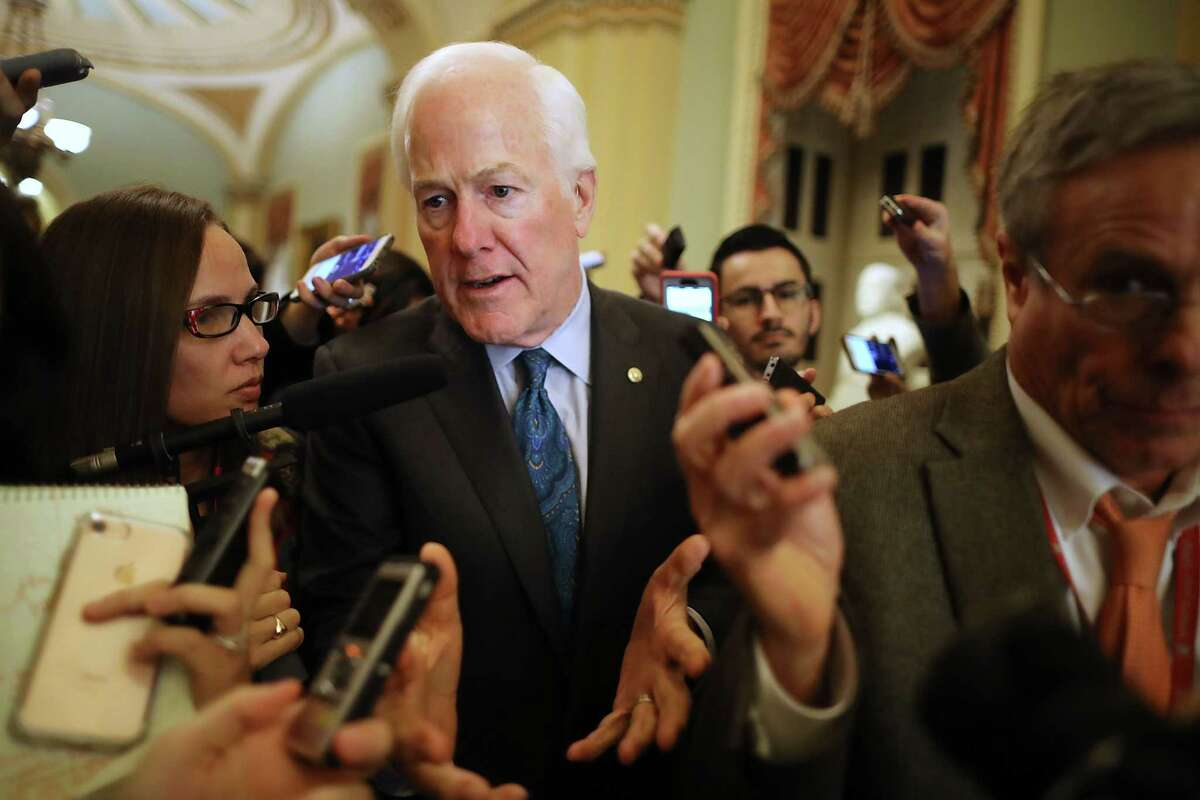 Senate Majority Whip John Cornyn of Texas talks to reporters Thursday about the proposed GOP tax reform bill at the U.S. Capitol.