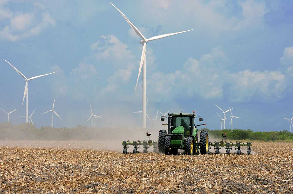 A farmer plows his harvested field in 2015 in the agricultural area north of Rio Hondo, Texas. (Jason Hoekema/Valley Morning Star via AP)