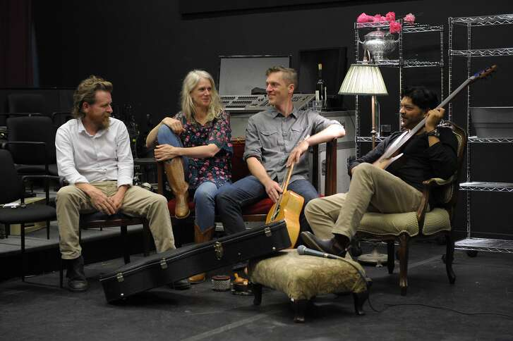 """From left: band members Gabe Maxson, Beth Wilmurt, Sam Barnum and Olive Mitra take a break during rehearsal for """"OLGA A Farewell Concert"""" at Aurora Theatre."""