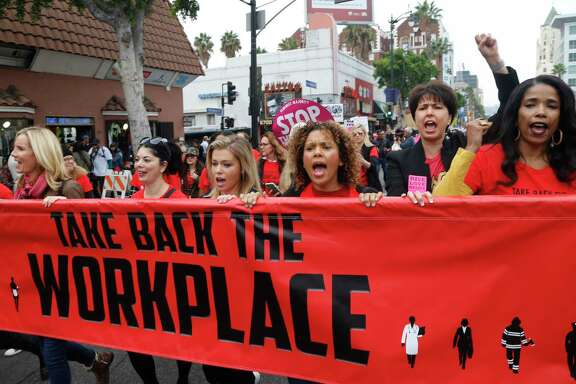 Participants march against sexual assault and harassment at the #MeToo March in the Hollywood section of Los Angeles in November.