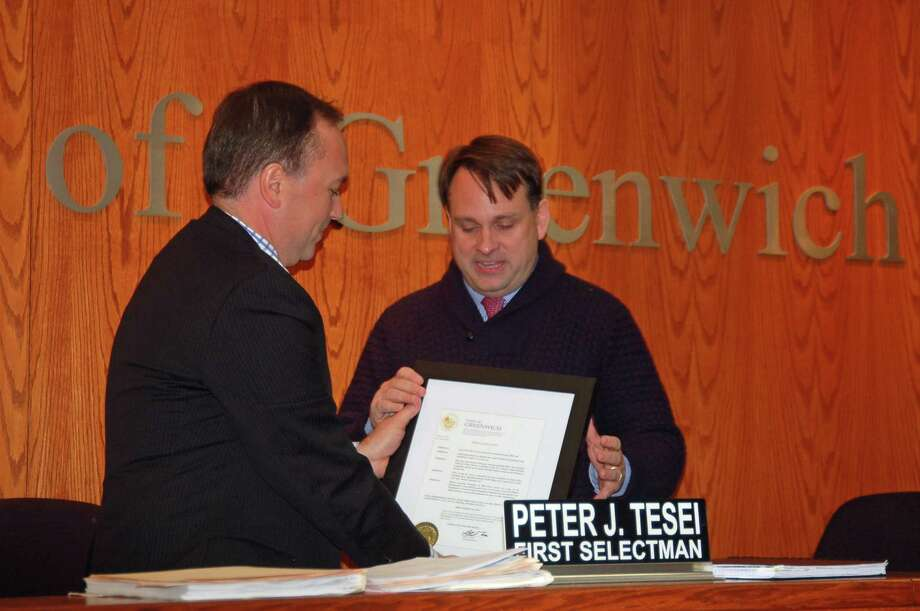 First Selectman Peter Tesei, left, presents a proclamation to Selectman Drew Marzullo Thursday at Town Hall. The citation declared Nov. 30, 2017 to be Drew Marzullo Day in Greenwich. Photo: Ken Borsuk