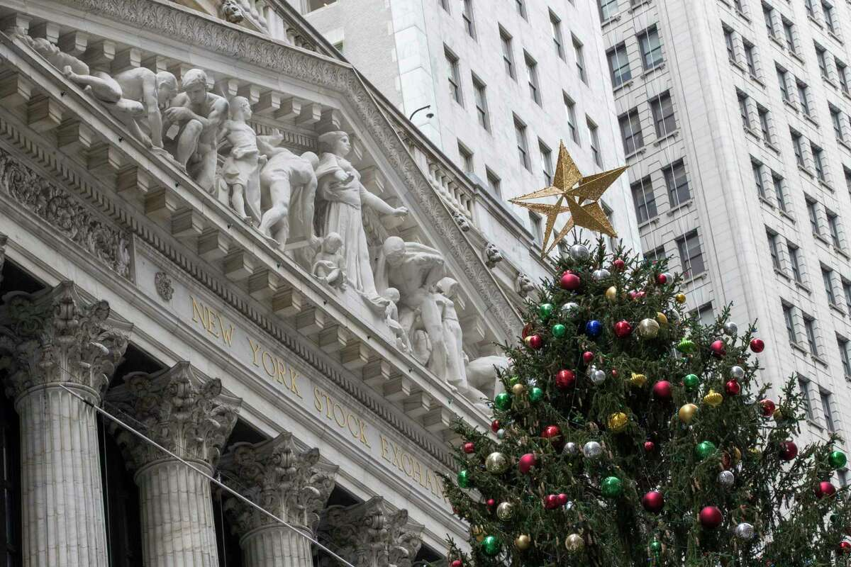 A golden star tops the Christmas tree outside the New York Stock Exchange, Thursday, Nov. 30, 2017. Stocks powered to new highs on Wall Street, giving the Dow Jones industrials their biggest gain since March and putting them past 24,000 for the first time. (AP Photo/Mary Altaffer) ORG XMIT: NYMA102