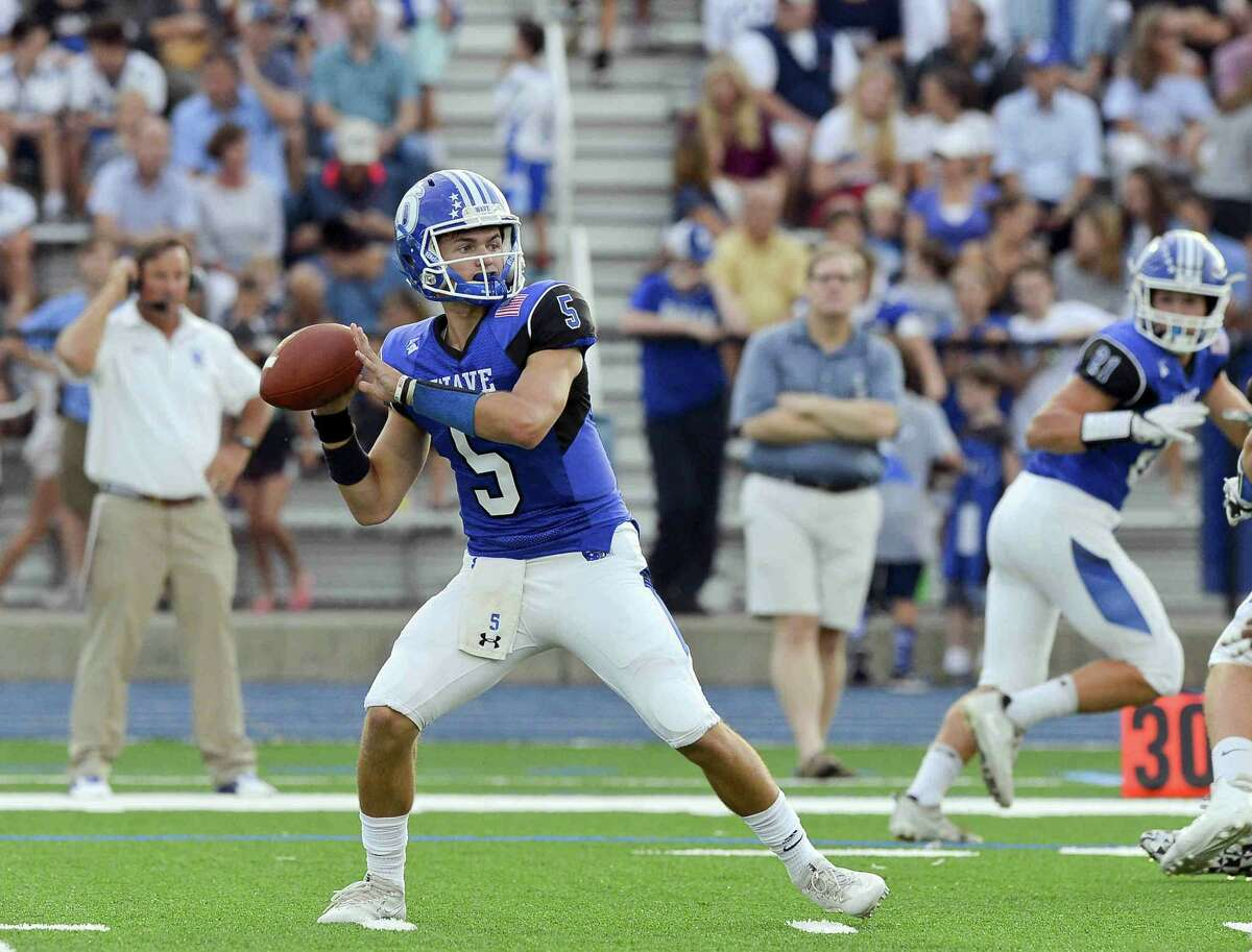 Darien Jack Joyce looks for the deep pass against Brien McMahon in a FCIAC football game on Friday, Sept. 15, 2017 in Darien, Connecticut. Darien defeated Brien McMahon 47-0 in their first game at the school under the lights.