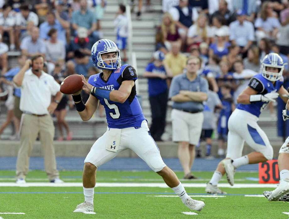 Darien Jack Joyce looks for the deep pass against Brien McMahon in a FCIAC football game on Friday, Sept. 15, 2017 in Darien, Connecticut. Darien defeated Brien McMahon 47-0 in their first game at the school under the lights. Photo: Matthew Brown / Hearst Connecticut Media / Stamford Advocate