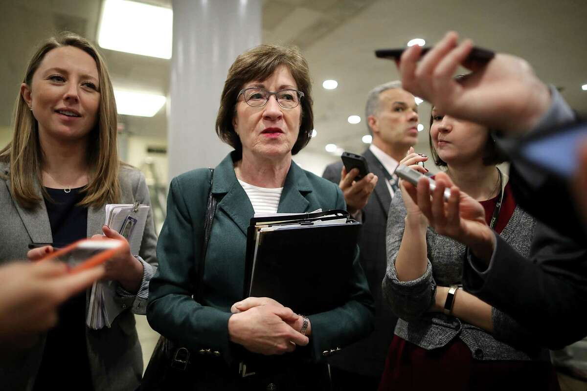 WASHINGTON, DC - NOVEMBER 30: Sen. Susan Collins (R-ME) (C) talks to reporters between votes in the U.S. Capitol November 30, 2017 in Washington, DC. Collins has yet to say how she will vote on the GOP tax reform bill that is being debated in the Senate. (Photo by Chip Somodevilla/Getty Images) ORG XMIT: 775085706