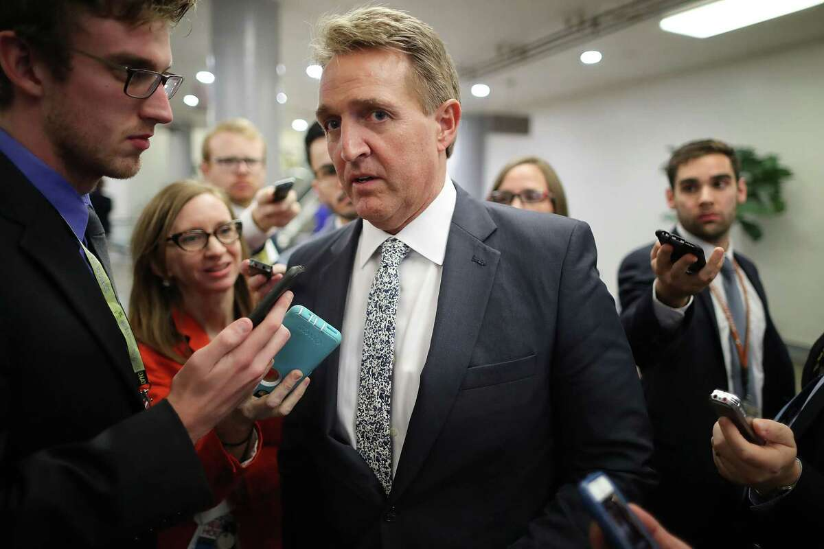 Sen. Jeff Flake talks to reporters in between votes at the U.S. Capitol on November 30, 2017 in Washington, DC.