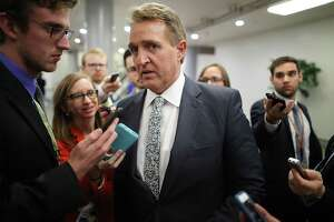WASHINGTON, DC - NOVEMBER 30:  Sen. Jeff Flake (R-AZ) talks to reporters in between votes at the U.S. Capitol November 30, 2017 in Washington, DC. Flake has yet to say how he will vote on the GOP tax reform bill that is being debated in the Senate.  (Photo by Chip Somodevilla/Getty Images) ORG XMIT: 775085706