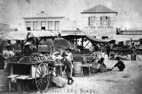 This photo of fruit vendors at stalls in Military Plaza is one of the most popular in the Raba Collection. It actually predates Raba's arrival in the city, though he was responsible for saving it for posterity.