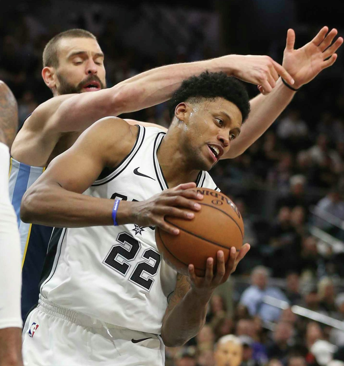 San Antonio Spurs' Rudy Gay snatches a rebound from Memphis Grizzlies' Marc Gasol during the second half at the AT&T Center, Wednesday, Nov. 29, 2017. The Spurs won 104-95.