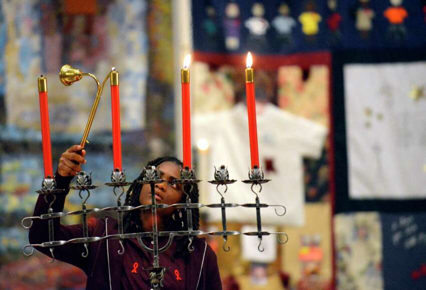 April Malachi, an outreach worker for Stamford Cares, lights candles of remembrance during a Remembrance, Awareness, Hope and Healing service for people whose lives have been touched by HIV/AIDS at First United Methodist Church on Thursday, Nov. 30, 2017 in Stamford, Connecticut. Over 150 clergy, community leaders and guests attended the program which featured musical selections by the Stamford High School Madrigals, AITE Gospel Choir, First United Methodist Church Chancel Choir, New World Chorus and dancing by Locust Contemporary Dance Works. The interfaith service coincides with the observance of World AIDS Day 2017.