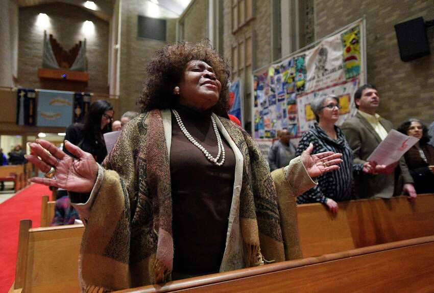 Pastor Helene Streeter of Stamford's Jesus is Lord Tabernacle church joins in with the singing of