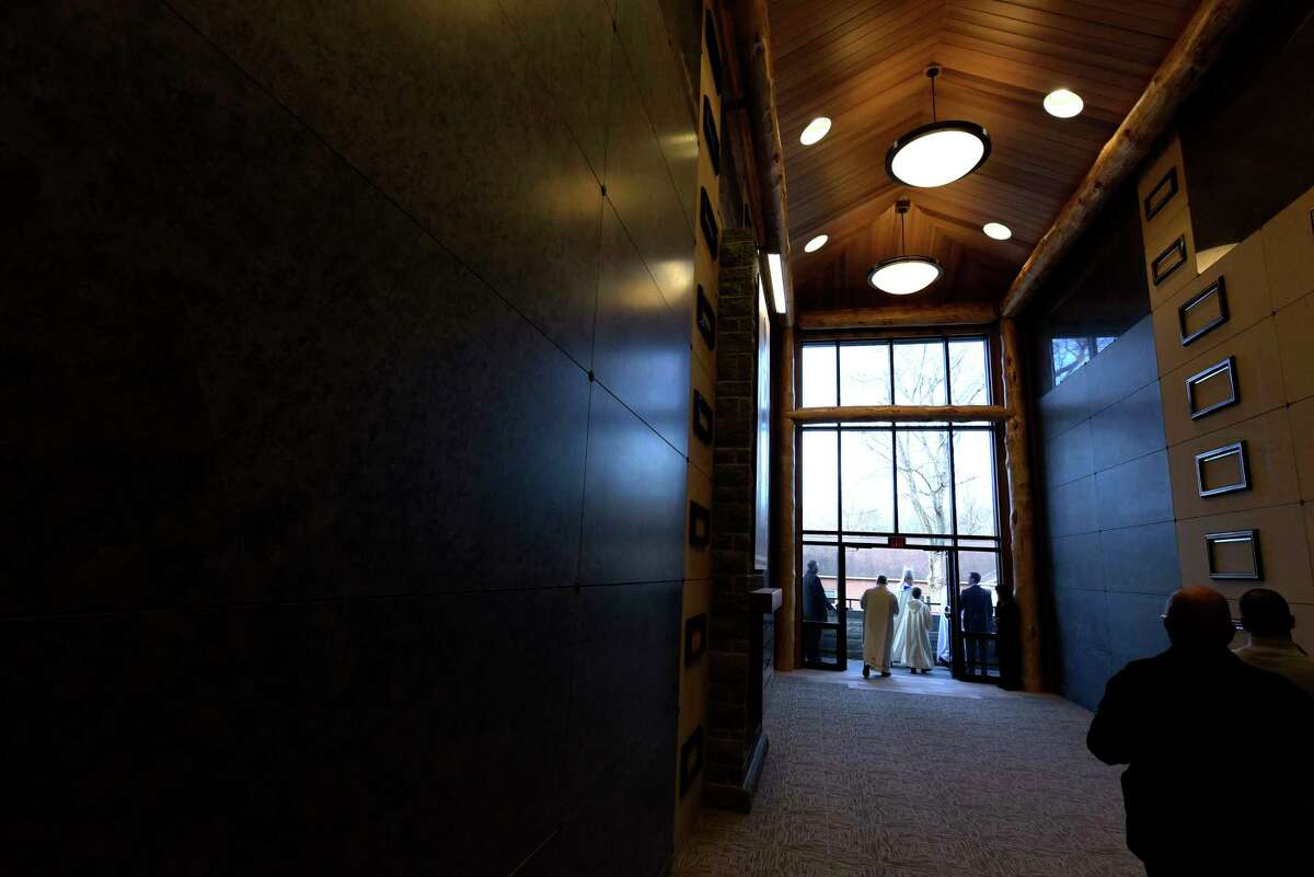 Bishop Edward Scharfenberger makes his way around to bless the crypts during a dedication of the new Mary Immaculate, Patroness of America at Most Holy Redeemer Cemetery Chapel Mausoleum on Thursday, Nov. 30, 2017, in Niskayuna, N.Y. The design of the mausoleum was done in the style of local architect and conservationist Paul Schaefer. The mausoleum has over 1,000 crypts and around 700 niches to hold cremation urns. (Paul Buckowski / Times Union)