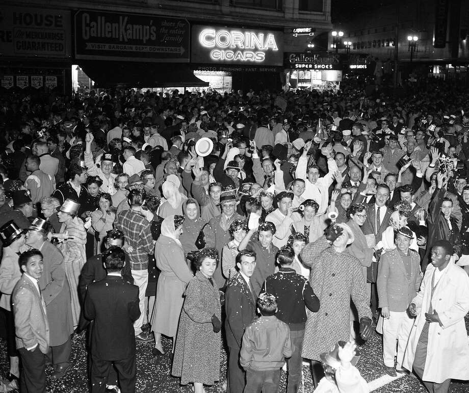 A crowd waits for midnight during celebrations on Market Street in San Francisco on December 31, 1959. Photo: Photographer Unknown, The Chronicle