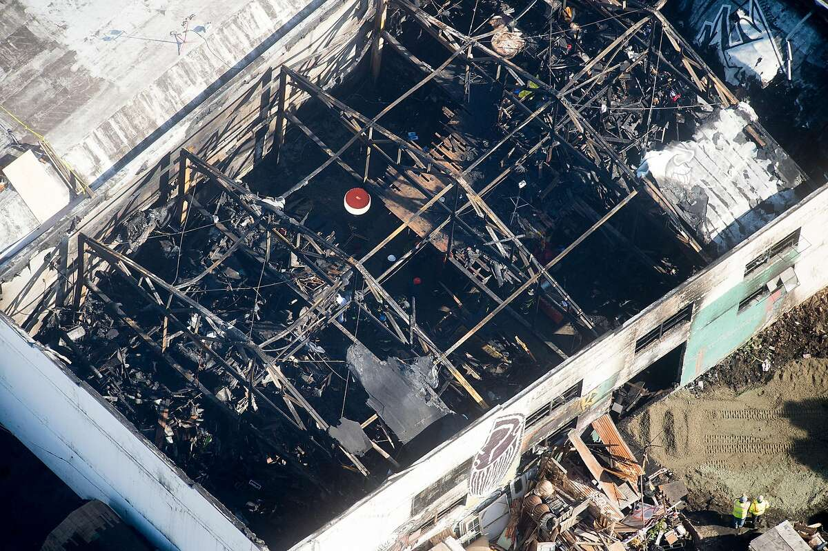 The Ghost Ship warehouse, site of a fire that killed at least 30 people, is pictured on Sunday, Dec. 4, 2016, in Oakland, Calif.