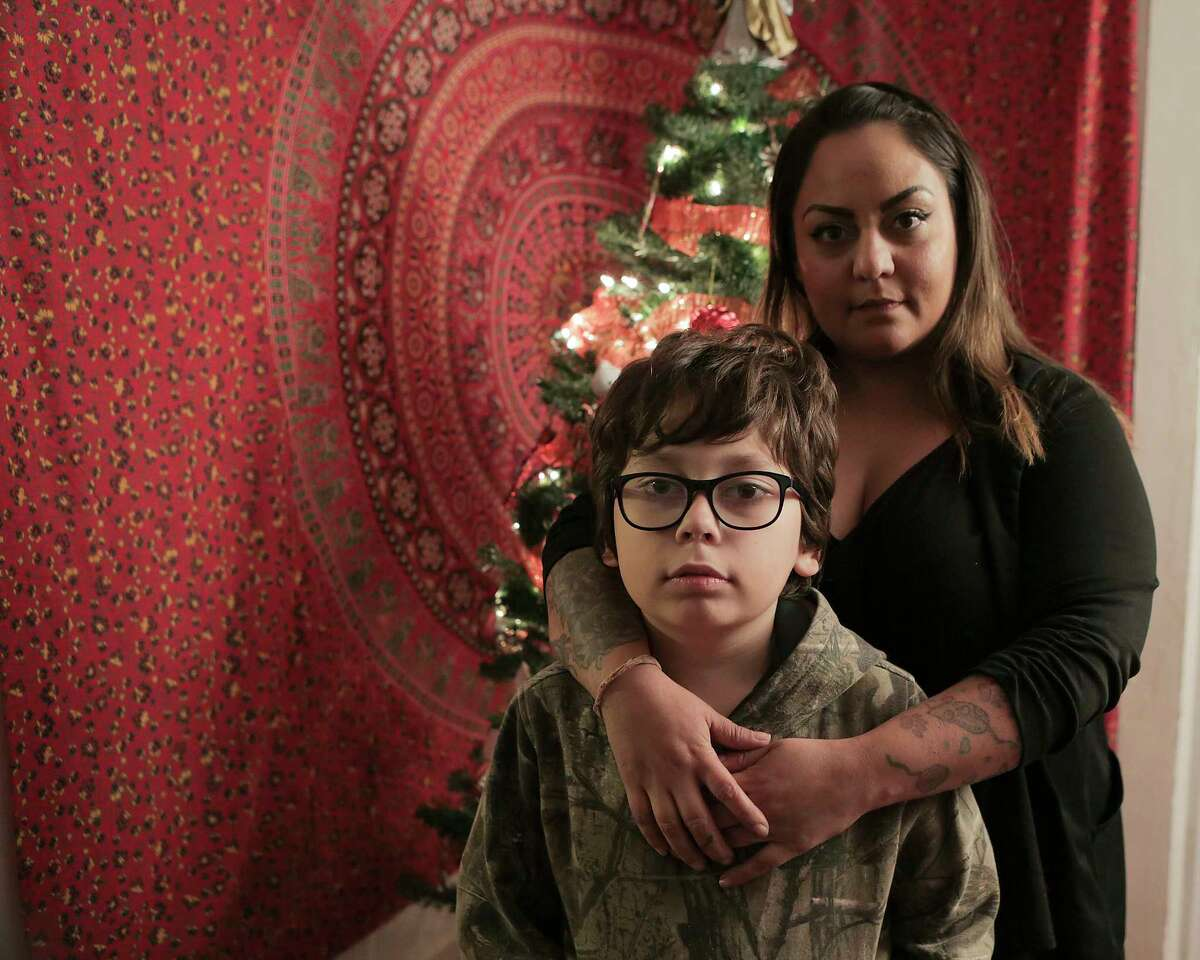 Lauren Kribbs in her Houston home with her son, Hunter Pruitt, 10, on Thursday, Nov. 30, 2017, in Houston. Kribbs has had multiple packages, which include Christmas presents for her son stolen from her porch. ( Elizabeth Conley / Houston Chronicle )