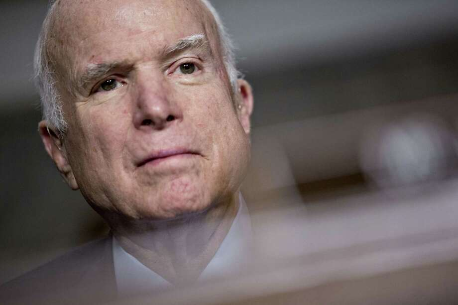 Senator John McCain, a Republican from Arizona and chairman of the Senate Armed Services Committee, listens during a hearing in Washington, D.C., U.S., on Thursday, Nov. 30, 2017. Photo: Andrew Harrer / © 2017 Bloomberg Finance LP