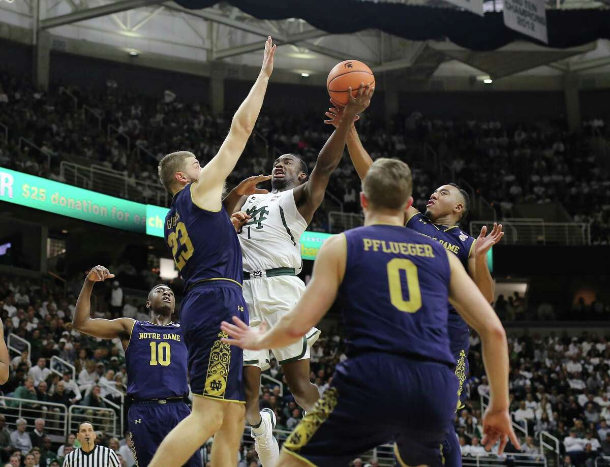 EAST LANSING, MI - NOVEMBER 30: Joshua Langford #1 of the Michigan State Spartans shoots and draws a foul against Bonzie Colson #35 of the Notre Dame Fighting Irish at Breslin Center on November 30, 2017 in East Lansing, Michigan. (Photo by Rey Del Rio/Getty Images) ORG XMIT: 775058358