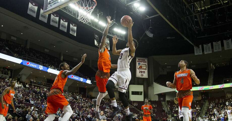 Texas A&M guard Admon Gilder (3) drives the lane against Texas-Rio Grande Valley forward Adonis Rwabigwi (32) forward Adonis Rwabigwi (32) during the first half of an NCAA college basketball game Thursday, Nov. 30, 2017, in College Station, Texas. (AP Photo/Sam Craft) Photo: Sam Craft/Associated Press