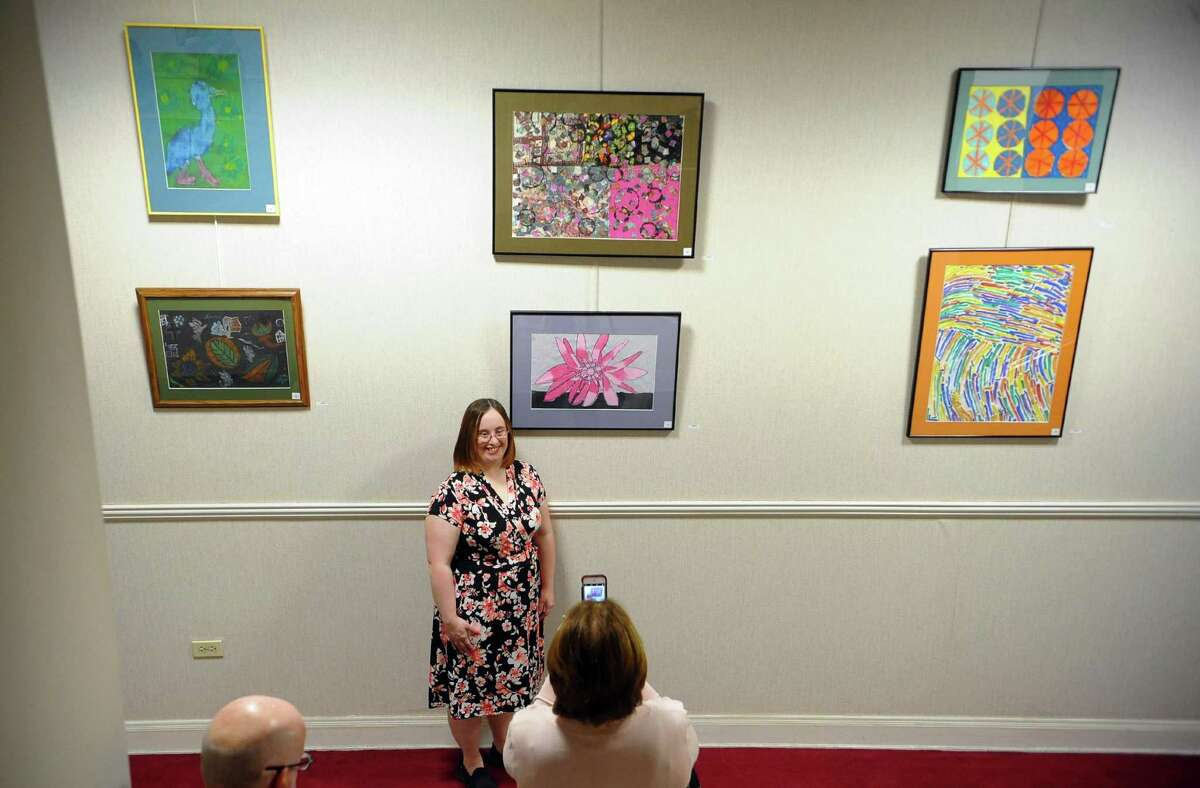 Meghan McCormack poses for a photo by her artwork during The Kennedy Center's. 2018