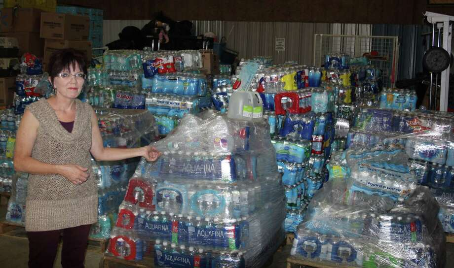 Heaven's Army Director Stephania Ward shows a huge collection of water the organization has on hand for the needy. Heaven's Army is focusing on helping out Hurricane Harvey victims this year. Photo: Jacob McAdams