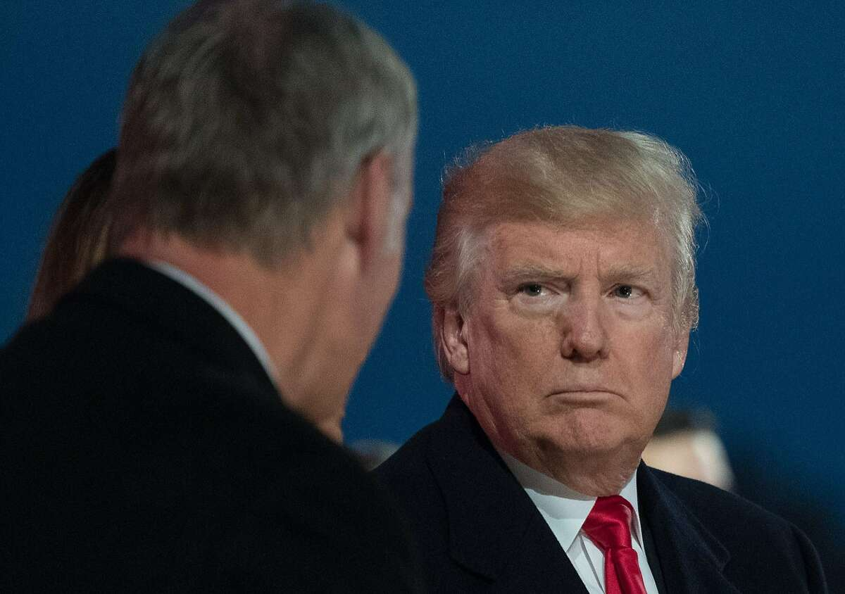 US President Donald Trump, speaks with US Secretary of the Interior Ryan Zinke during the 95th annual National Christmas Tree Lighting ceremony at the Ellipse in President's Park near the White House in Washington, DC on November 30, 2017. / AFP PHOTO / NICHOLAS KAMMNICHOLAS KAMM/AFP/Getty Images