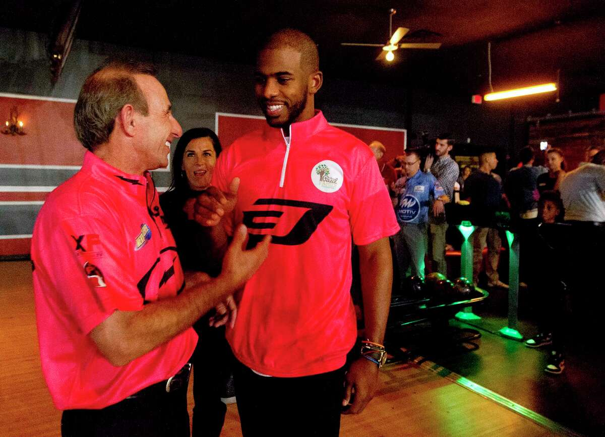 Rockets guard Chris Paul visits with professional bowler Norm Duke during the CP3 PBA Celebrity Invitational at Bowlero on Thursday. Paul was joined by teammate James Harden and Red Sox outfielder Mookie Betts among others.