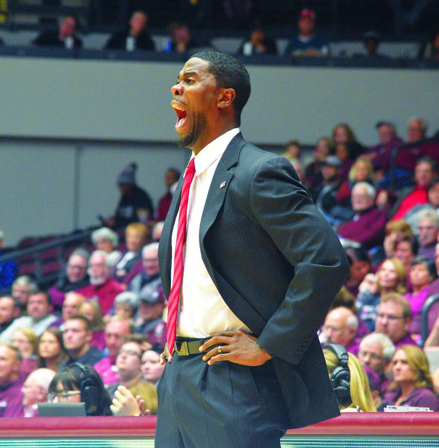 SIUE coach Jon Harris shouts out instruction to his team during first-half action Wednesday in Carbondale.