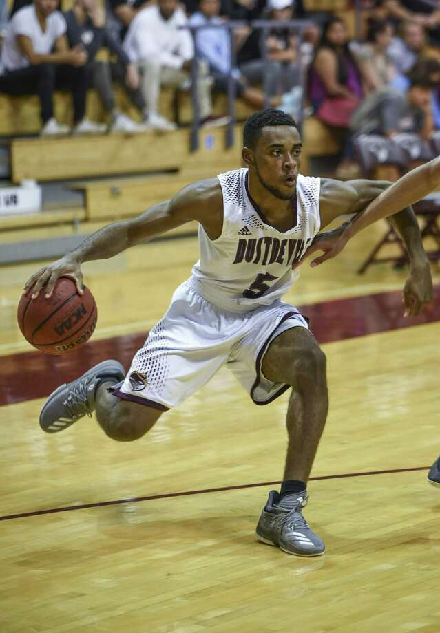 Point guard Jeremy Wright had a career-high 31 points in the Dustdevils 84-72 loss to No. 22 Dallas Baptist in the Heartland Conference tournament quarterfinal opener Thursday night. TAMIU gave up a 21-2 run to end the final eight minutes of the first half in the defeat. Photo: Danny Zaragoza /Laredo Morning Times File