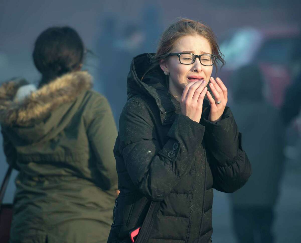 A woman is in tears as she realizes her home on Remsen Street is among those consumed by the blaze.