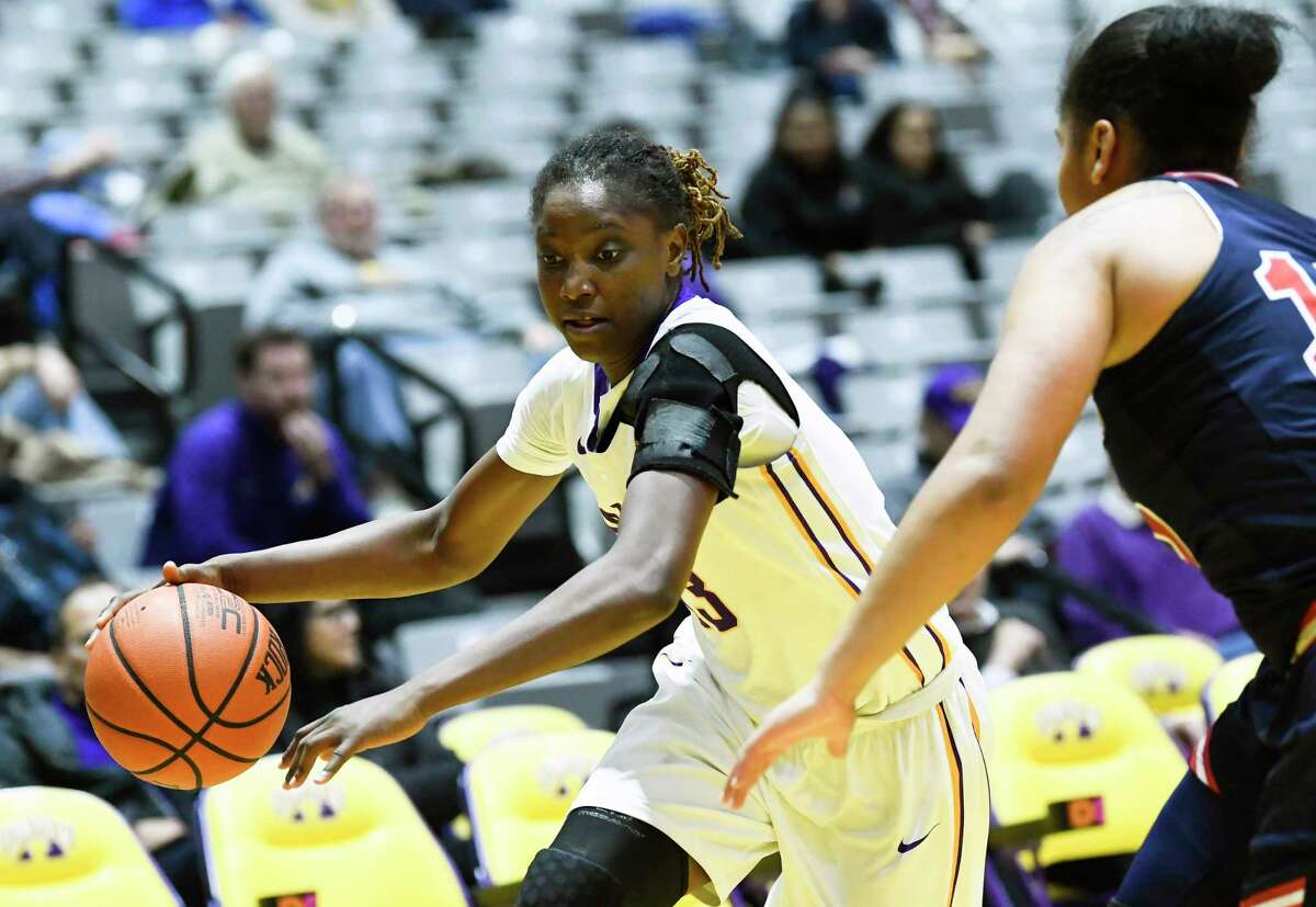 UAlbany's guard Bose Aiyalogbe (13) moves the ball against St. John's guard Andrayah Adams (15) during the second half of an NCAA college basketball game on Thursday, Nov. 30, 2017, in Albany, N.Y. St. John won the game71-66. (Hans Pennink / Special to the Times Union) ORG XMIT: HP105