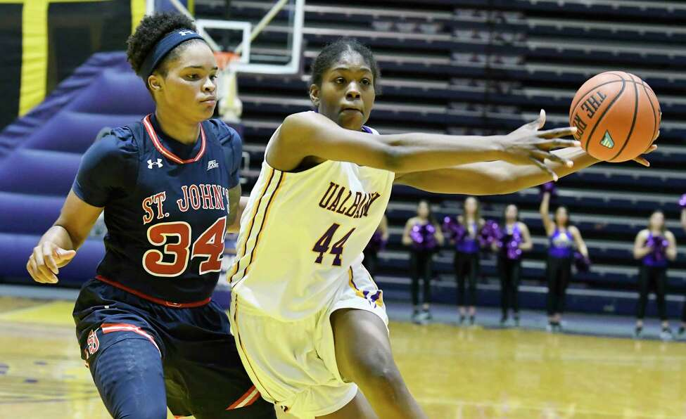 St. John's forward Maya Singleton (34) defends against UAlbany's forward Chyanna Canada (44) during the second half of an NCAA college basketball game on Thursday, Nov. 30, 2017, in Albany, N.Y. St. John won the game71-66.(Hans Pennink / Special to the Times Union) ORG XMIT: HP107