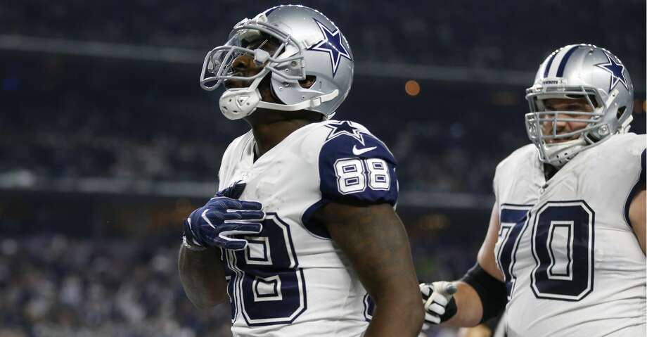Dallas Cowboys wide receiver Dez Bryant (88) and Zack Martin (70) celebrate a touchdown scored by Bryant in the second half of an NFL football game against the Washington Redskins on Thursday, Nov. 30, 2017, in Arlington, Texas. (AP Photo/Ron Jenkins) Photo: Ron Jenkins/Associated Press